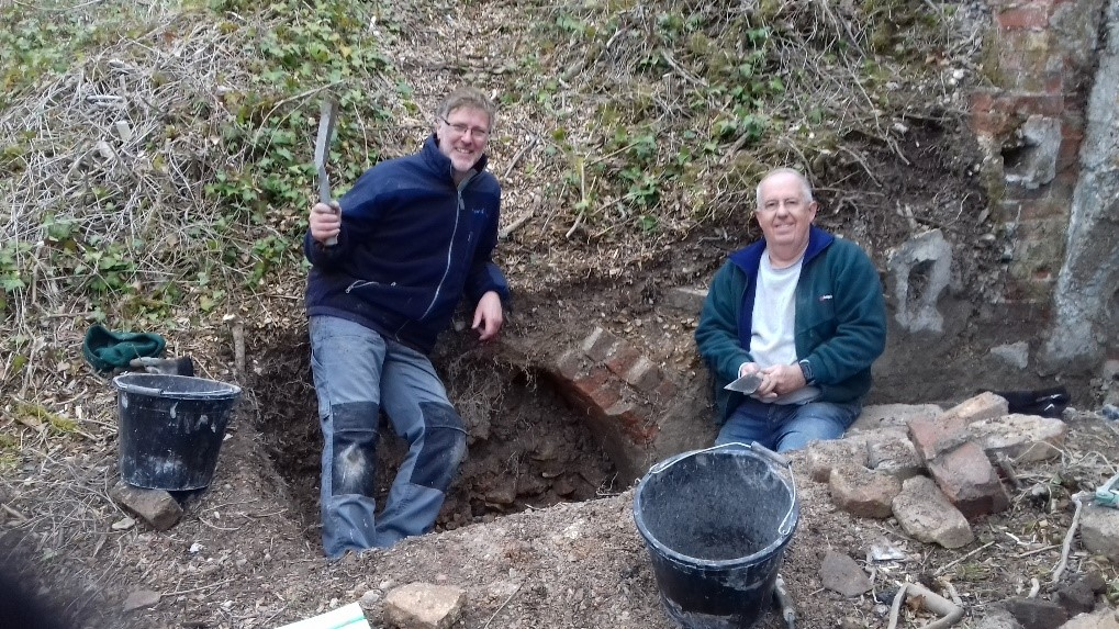 Andrew and Simon with the discovery of the front of the 4th Bottle Kiln